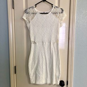 Fitted white lace cut out dress